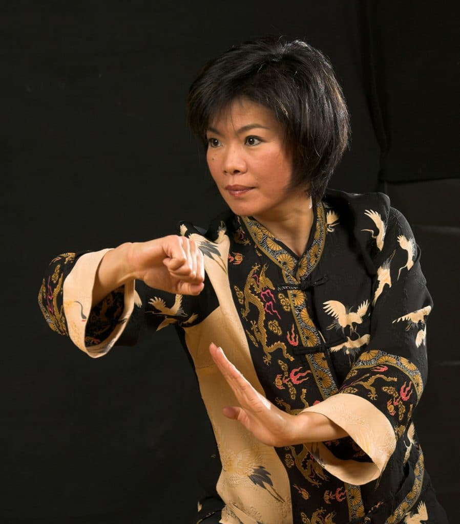 A Tai Chi player demonstrates a movement.